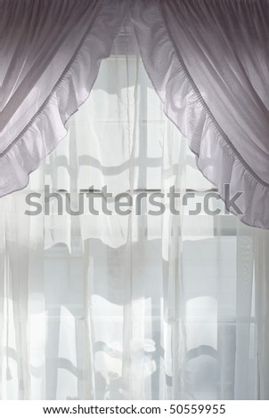 Sunlight Through a Curtained Window