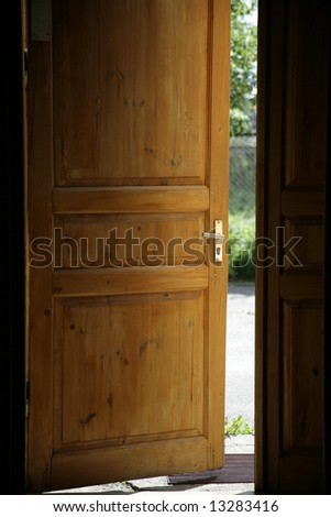 sunlight through the unclosed door of house