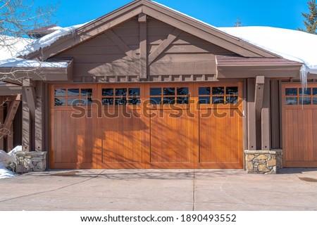 Sunlit exterior of home in Park City Uta with glass paned brown garage door Stock fotó ©