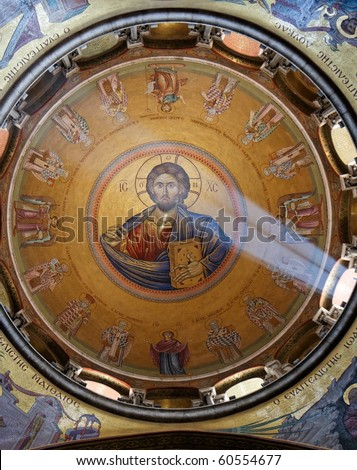 Sunlit painting of Jesus Christ on dome of Church of the Holy Sepulchre in Jerusalem