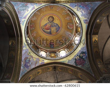 Sunlit painting of Jesus Christ on dome of Church of the Holy Sepulchre in Jerusalem - stock photo