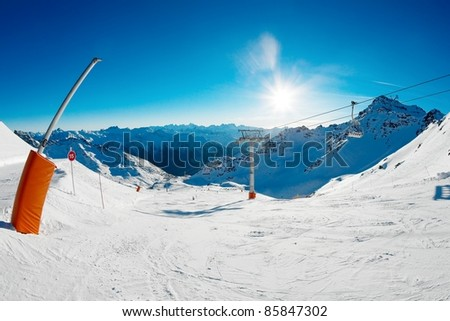 Sunlit slope of a ski resort