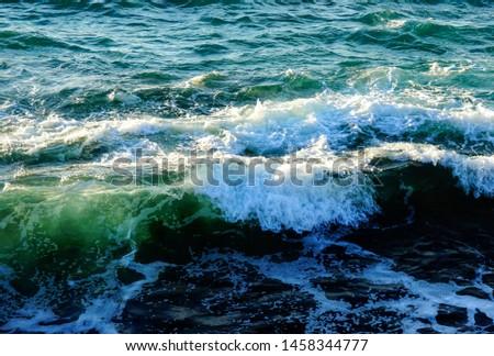 Sunlit waves along California shoreline #1458344777