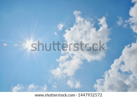 Sunny background, blue sky with white clouds and sun #1447932572