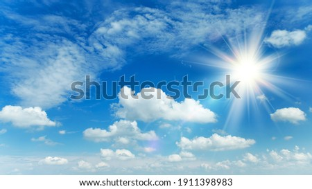 Sunny background, blue sky with white clouds and sun Foto stock ©