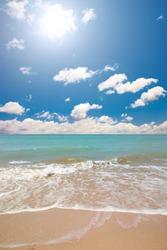 sunny beach landscape with cloudy sky