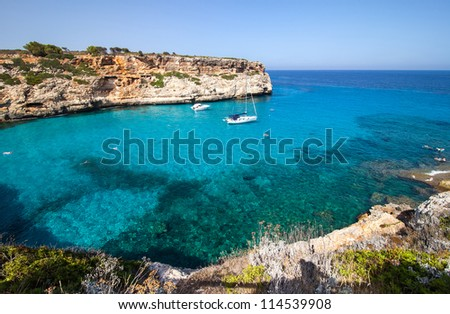 Sunny blue lagoon in Majorca with clear waters