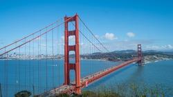 Sunny blue sky view of Golden Gate Bridge in San Francisco Bay