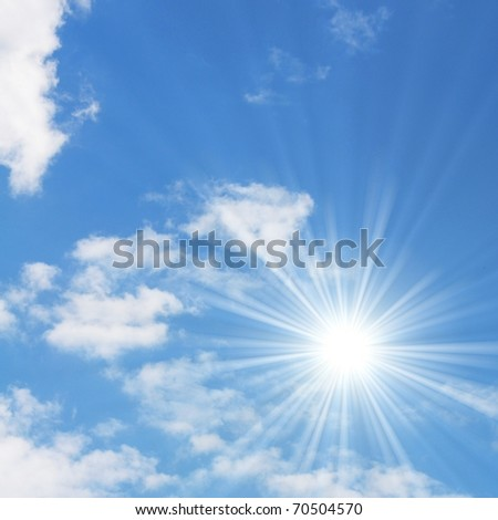 sunny blue sky with white fluffy clouds
