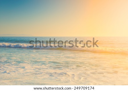 Sunny bright colorful day and wavy ocean, vibrant colors
