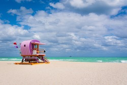 Sunny coastal beach with colorful life guard tower at South Beach, Miami-Dade, Florida USA