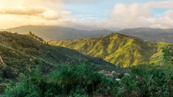 Sunny Costa Rican mountains with agricultural coffee and banana plantations