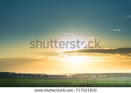 sunny dawn in a field. #717021850
