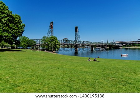 Sunny day at the Tom McCall Waterfront Park on the Willamette River near the Hawthorne Bridge Portland Oregon USA #1400195138