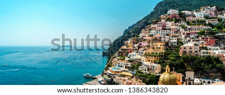 Sunny day in amazing Amalfi coast panoramic view, colorful hillside houses on the mountain, blue Mediterranean Sea famous tourist resort Positano, copy space for touristic advertisement text, Italy   #1386343820