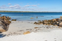 Sunny day in beach with sand and rocks  in Carraroe, Conemara, Galway, Ireland