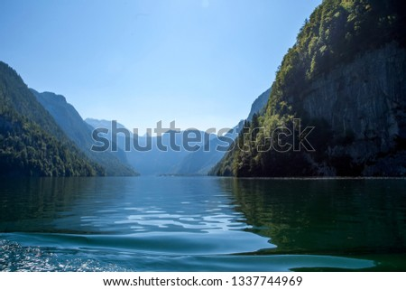 Sunny day in the Alps in Austria. Interesting reflection in the water. Beautiful blue, emerald water in the lake on a Sunny day #1337744969