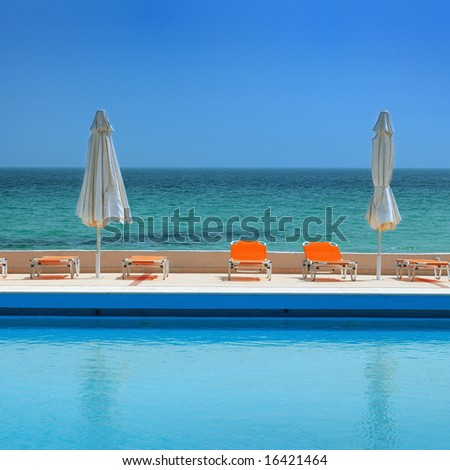 sunny day on a swimming pool, beach view
