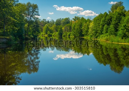 Sunny day on the quiet river in summer in Ukraine
