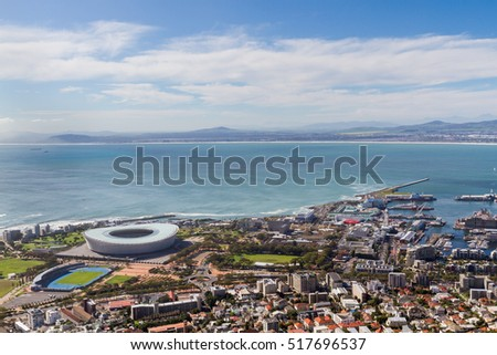Sunny day overview of Cape Town Stadium, Green Point, and V&A Waterfront, Cape Town, South Africa #517696537