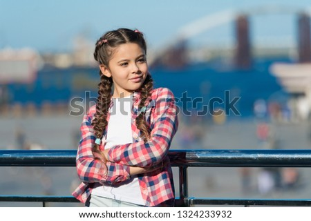 Sunny day walk. Leisure options. Free time and leisure. Girl cute kid with braids relaxing urban background defocused. Organize activities for teenagers. Vacation and leisure. What do on holidays.
