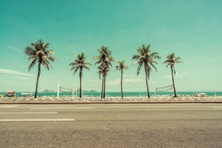 Sunny day with Palms on Ipanema Beach in Rio De Janeiro, Brazil. Low angle shot with vintage colors