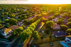 Sunny days ahead, Sunset real estate suburb homes. Community suburbia neighborhood in north Austin in suburb Round Rock , Texas Aerial drone view above new development