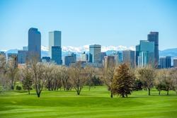 Sunny Denver Skyline. Spring in Colorado. Denver Skyline and Snowy Rocky Mountains.