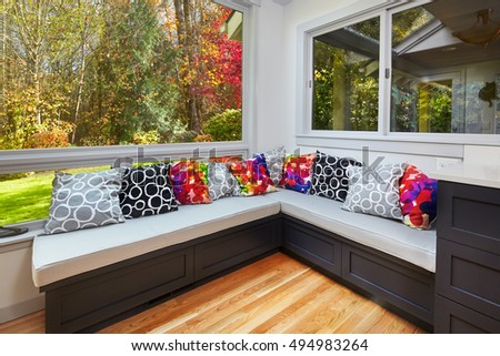 Sunny fall view from remodeled kitchen window bench seats