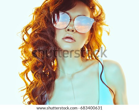 Sunny fashion photo of beautiful woman in pink-blue sunglasses. Beach summer vibes