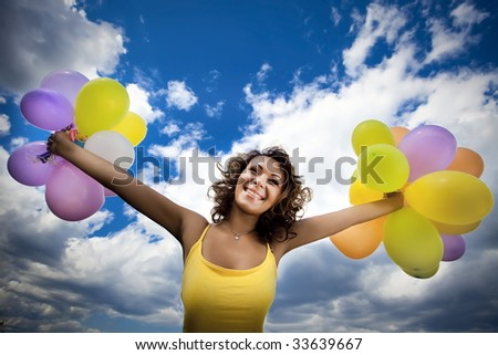 sunny girl with multicolored balloons