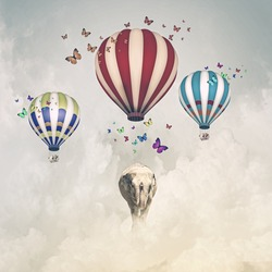 Sunny image of elephant flying in sky on aerostat