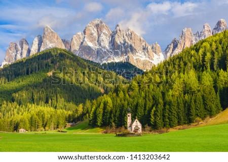 Sunny landscape of Dolomite Alps. St Johann Church with beautiful Dolomiti mountains, Santa Maddalena, Val Di Funes, Dolomites, Italy. Zdjęcia stock ©