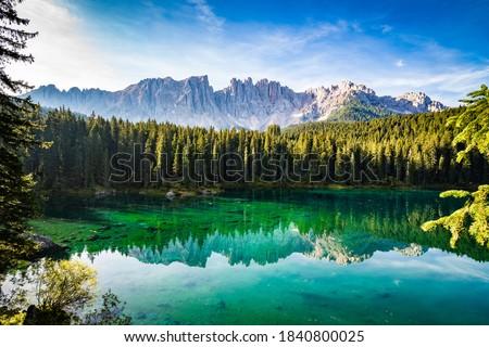 Sunny morning in Lake Carezza / Lago di Carezza / Karersee in Dolomites (Dolomiti), South Tyrol, Italy. Zdjęcia stock ©