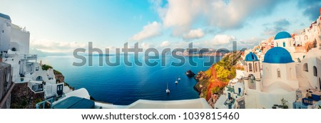 Sunny morning panorama of Santorini island. Colorful spring view offamous Greek resort Fira, Greece, Europe. Traveling concept background. Artistic style post processed photo.
