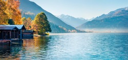 Sunny morning panorama of Zell lake. Picturesque autumn view of Austrian Alps, with Grossglockner peak on background. Beauty of nature concept background.