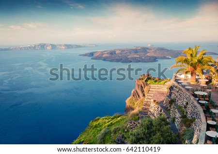 Sunny morning view of Santorini island. Picturesque spring sunrise on the famous Greek resort Fira, Greece, Europe. Traveling concept background. Artistic style post processed photo. #642110419