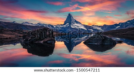 Sunny morning view of Stellisee lake with Matterhorn/Cervino peak on background. Captivating autumn scene of Swiss Alps, Zermatt resort location, Switzerland, Europe.