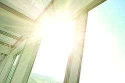 Sunny on modern glass office buildings windows