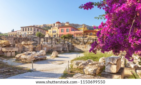 Sunny panoramic view of the Library of Hadrian, Athens, Greece. It is one of the main landmarks of Athens. Beautiful scenery of Athens with ancient Greek ruins. Historical architecture of Athens.