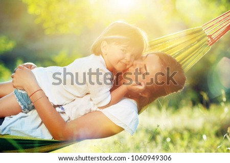 sunny picture of a mother with...
