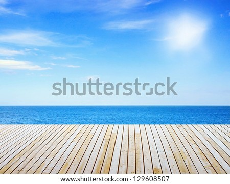 Sunny sea and wooden walkway