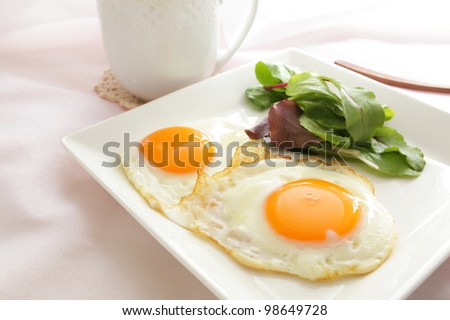 Sunny side up and baby leaves for breakfast