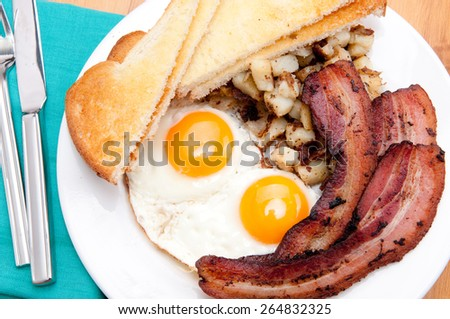 sunny side up eggs with organic bacon, hashbrowns and crsipy  toast
