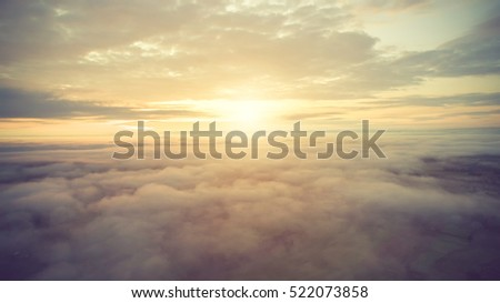 Sunny sky abstract background, beautiful cloudscape, on the heaven, view over white fluffy clouds, freedom concept.soft focus.Vintage color