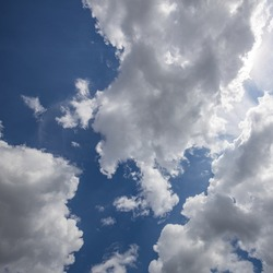 Sunny sky. Blue sky background with clouds sun rays. relaxing nature skyscape