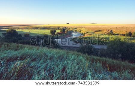 Sunny summer landscape.River Upa at sunset.Tula region, Russia  #743531599