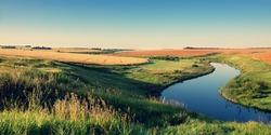 Sunny summer landscape.River Upa in Tula region, Russia.Wheat fields at sunrise.Beautiful view.