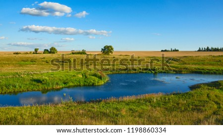 Sunny summer landscape with fields,river and beautiful woods.Tula region,Russia