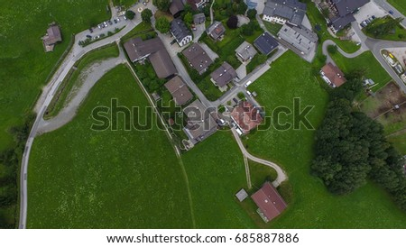 Sunny view of alpine Leogang village. Picturesque scene. Popular tourist attraction. Austrian alps, Saalfelden. Salzburg, Europe. Beautiful green summer meadow. Aerial drone photography. Beauty world. #685887886